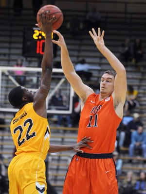 UTEP's Jake Flaggert (11) passes the ball against Southern Mississippi's Quinton Campbell (22) during an NCAA college basketball game Thursday, Jan. 28, 2016, in Hattiesburg, Miss.