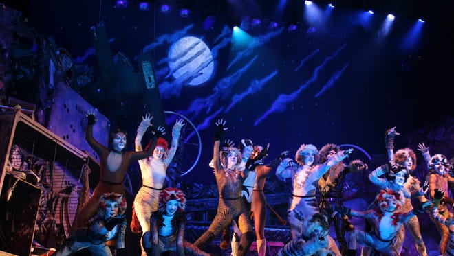 """The cast of """"Cats,"""" Abilene Christian University's 59th annual homecoming musical, dances under the moon at the Abilene Convention Center."""