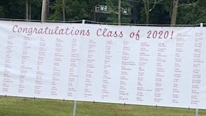 A banner listing all of the graduating Belmont High Seniors on the front lawn of the 1853 William Flagg Homer House, 661 Pleasant St., Belmont.