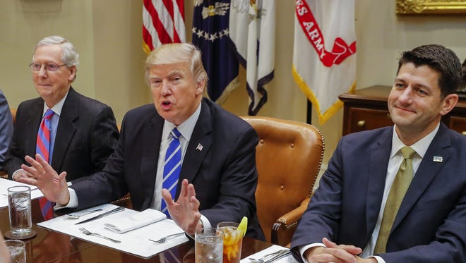 From left, Senate Majority Leader Mitch McConnell, President Trump and House Speaker Paul Ryan.