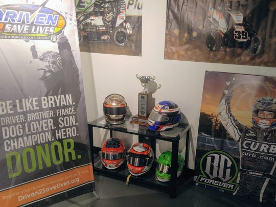 A banner at the Clauson-Marshall Racing Shop in Fishers promotes organ donations.