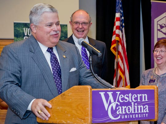 Thomas M. Apodaca, left, speaks at a Western Carolina University event in 2014. The WCU Board of Trustees voted to name the university's planned science facility in honor of the former state senator.