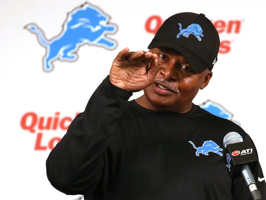 Lions head coach Jim Caldwell talks with the media