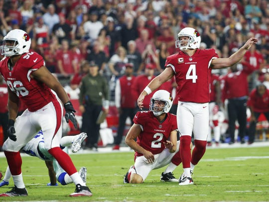 Arizona Cardinals kicker Phil Dawson (4) watches a