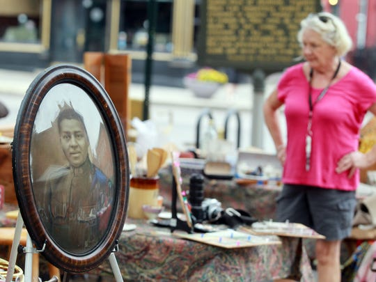 A chalk portrait of a World War I soldier was among items offered for sale in MainStrasse, Covington, at a previous World's Longest Yard Sale.