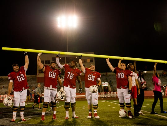 Austin Peay players stand in the middle of the field,