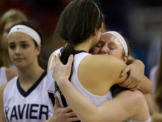 Xavier's Erin Powers (left) and Anna Loken embrace following Saturday's loss to Whitewater in the WIAA Division 3 girls' state championship game at the Resch Center in Ashwaubenon.