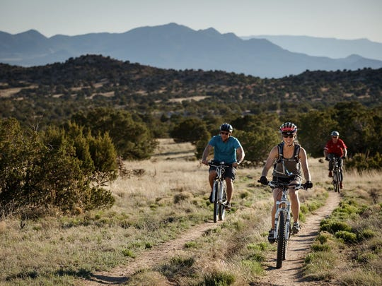 Bicyclists on one of the trails at Galisteo Basin Preserve,