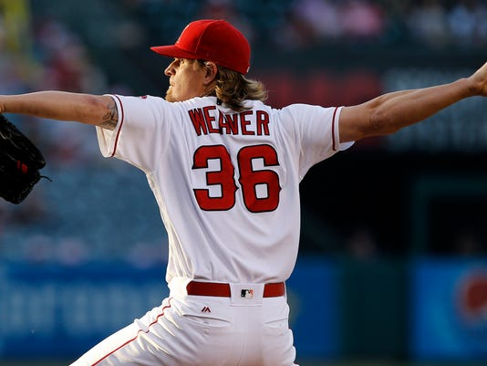 Los Angeles Angels starting pitcher Jered Weaver throws to the plate against the Oakland Athletics during the first inning of a baseball game in Anaheim, Calif., Friday, June 24, 2016. (AP Photo/Alex Gallardo)