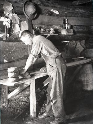 George Donkel works at Reems Creek Pottery, ca. 1914-17. This image is from the William A. Barnhill Collection, Southern Appalachian Archives, Mars Hill University.