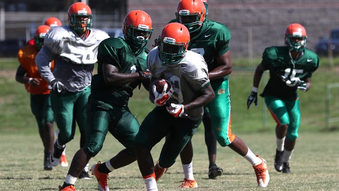 The FAMU football team practices on the university's campus on Monday, July 31, 2017.
