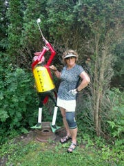 Michele Tidick, posing with The Tinman Golfer at Cortland