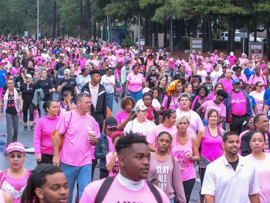 Thousands of people participate in Pensacola's 15th annual Making Strides Against Breast Cancer 5K walk last year.