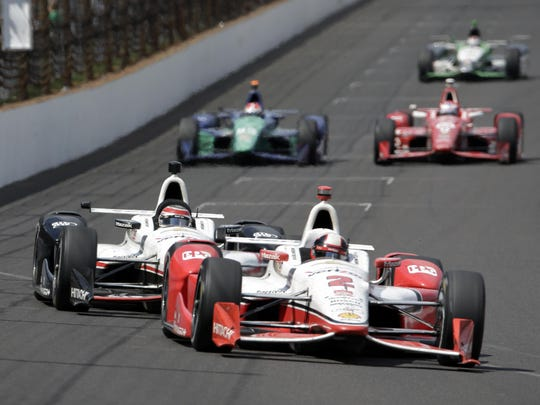 Juan Pablo Montoya, of Colombia, leads Will Power,