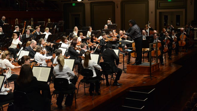Giancarlo Guerrero conducts the Nashville Symphony Orchestra during a brief performance.