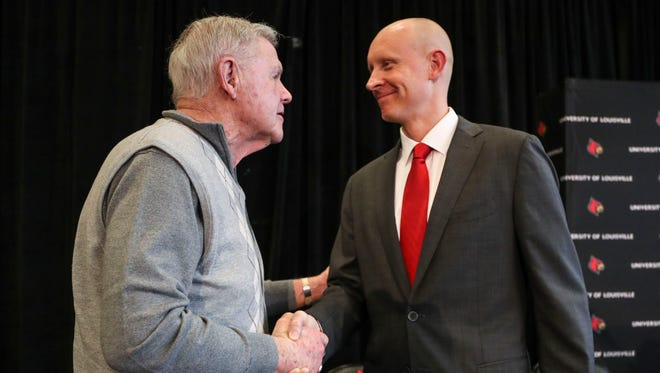 New Louisville basketball coach Chris Mack greets Hall of Famer and former UofL coach Denny Crum after his introductory press conference at the KFC Yum! Center Wednesday afternoon, March 28, 2018.