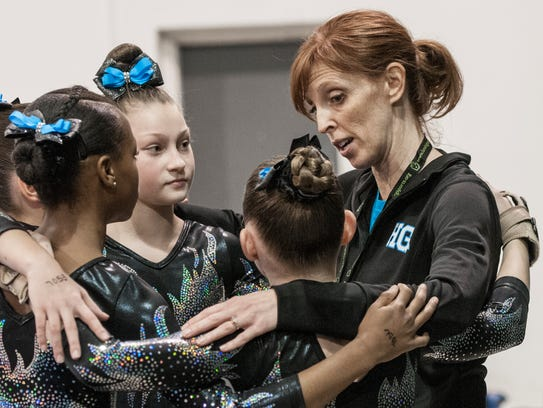 These young gymnasts from Hunts Gymnastics gather around