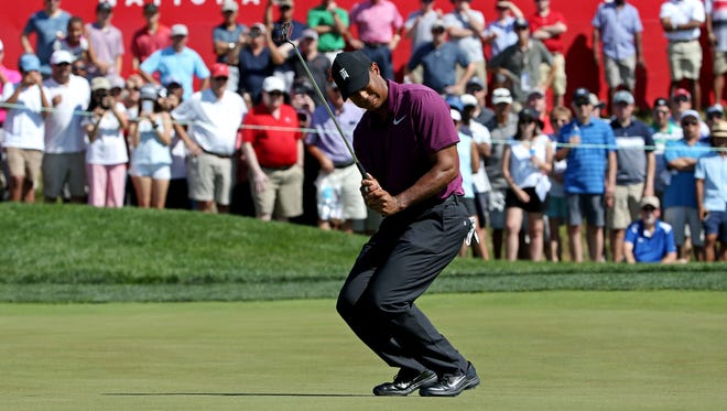Tiger Woods putts on the 16th green during the second round of the Quicken Loans National golf tournament at TPC Potomac at Avenel Farm.