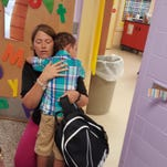 Grant Line kindergarten teacher Jennie Hamilton comforts a boy who is briefly overwhelmed on the first day of school.