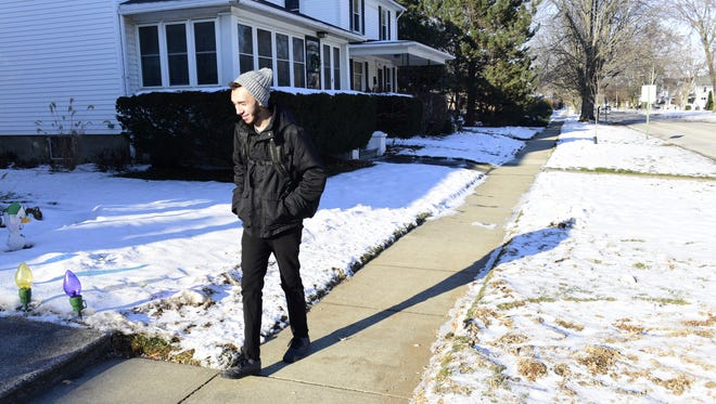 Jesus Cruz, senior at Fremont Ross High School, walks home on Monday afternoon, in a chilly temperature of 10 degrees.