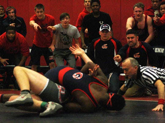 John Glenn's wrestlers and coaches react when JaWuan Peete came within inches of pinning Bedford's Austin Emerson in the 215-pound match.