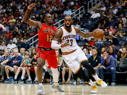 Cleveland Cavaliers forward LeBron James (23) drives past Atlanta Hawks forward Taurean Prince (12) in the second quarter at Philips Arena.