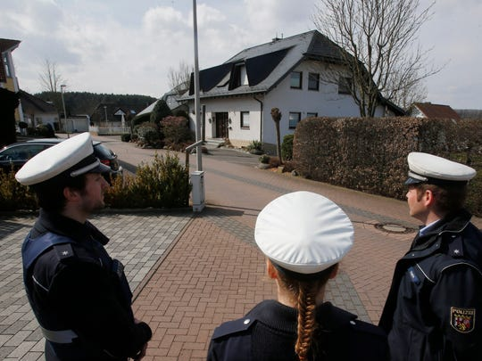 Police keep media away from the house where Andreas