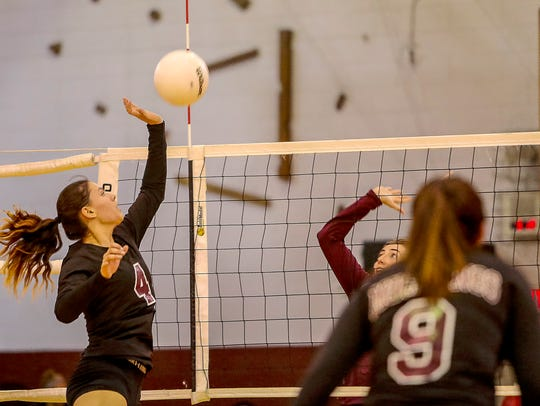 Kristen Kakascik (4) and Clifton enter the state volleyball