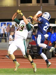 CVC's Connor Paden, 22, catches a TD pass over Kingsburg's