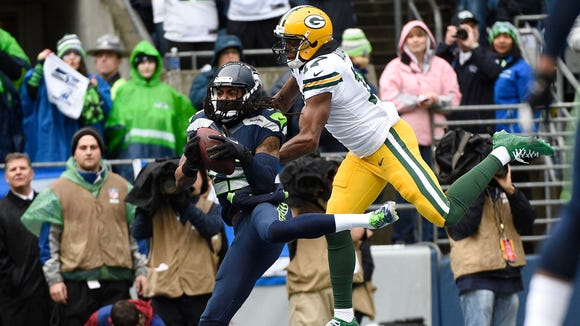 Richard Sherman (25) intercepts a pass intended for Green Bay Packers wide receiver Davante Adams (17) during the first half in the NFC Championship Game in 2015.