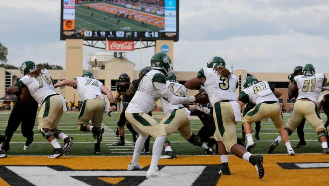 Charlotte 49ers quarterback Hasaan Klugh (16) hands off to Charlotte 49ers running back Kalif Phillips (3) against the Southern Miss Golden Eagles. The Blue Raiders will have to stop the dynamic duo on Saturday.