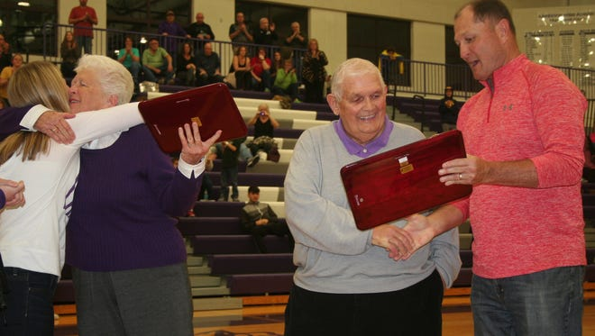 Lakeview created a new award - the Gary Beard Lifetime Service Award - and former Spartan AD Greg Hermsen, right, presented it to its namesake Gary Beard and his wife Marlene Beard on Friday.