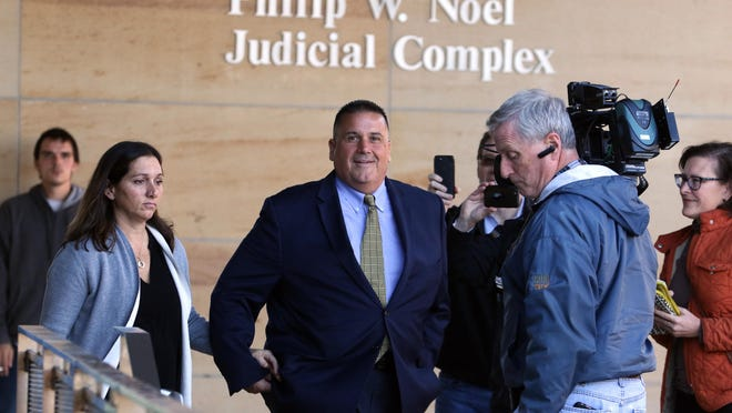 Jeffrey Britt, center, leaves Kent County Superior Court after his arraignment in November 2019. He will go on trial Monday on charges of money laundering and making an illegal campaign contribution.