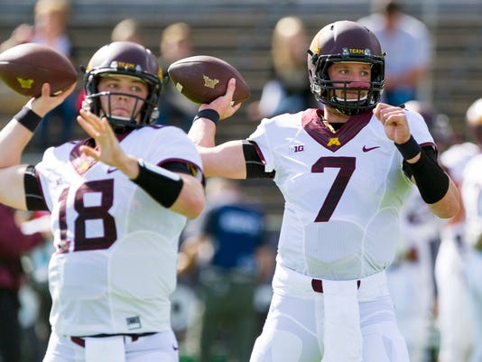 Minnesota quarterbacks Mitch Leidner (7) and Jacques Perra (18) throw during pregame warmups before an NCAA college football game against Purdue, Saturday, Oct. 10, 2015, in West Lafayette, Ind. (AP Photo/Doug McSchooler)
