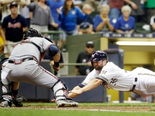 Atlanta Braves catcher A.J. Pierzynski tags out the Milwaukee Brewers' Shane Peterson at home during the fifth inning on Monday, July 6, 2015, in Milwaukee. Peterson tried to score from first on a hit by Gerardo Parra.