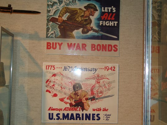Posters are part of the exhibit that pays homage to those who served during World War II.