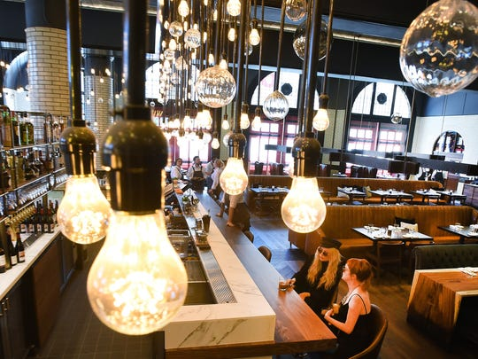 An empty downtown firehouse was turned into the stylish Detroit Foundation hotel in May. Its restaurant, the Apparatus Room, features original firehouse doors,  lighting by Insight Detroit Lighting, glazed tile and other accents supplied by local artists.