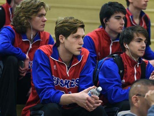 Reno's Tommy Challis sits with teammate as they watch