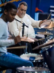 Drummer Tommy Beavers works with young drummers as the Montgomery Area Musicians Association holds a drumming workshop at the Boys and Girls Club on Lower Wetumpka Road in Montgomery, Ala. on Saturday December 9, 2016.
