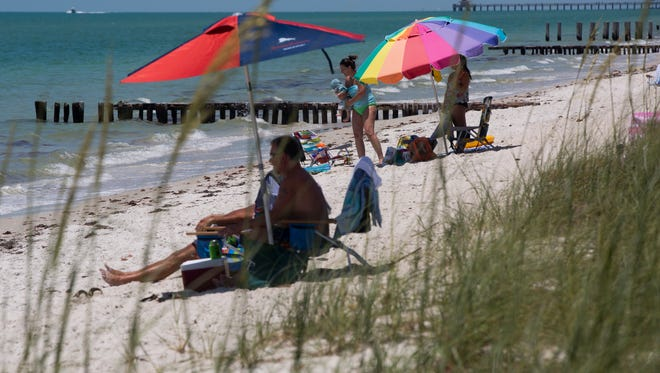 A patchy algae bloom that can look like sawdust or murky water has washed ashore in spots from Marco Island to North Naples this week, beach monitors report. A section of beach can be seen just south of the Naples Pier Thursday, May 11, 2017 in Naples.