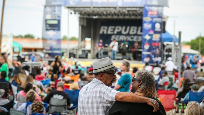 A crowd gathers on Oakes Street for the Simply Texas Blues Festival Saturday, May 19, 2018, in downtown San Angelo.