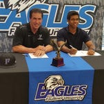 Washington High School outfielder Brandon Rembert signs a baseball scholarship with Faulkner University.