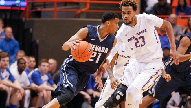 Nevada's Eric Cooper Jr (21) moves the ball around Boise State's James Webb III during the first half Wednesday.