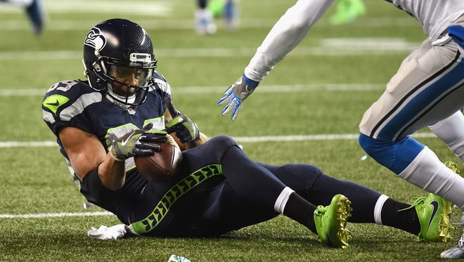Seattle Seahawks wide receiver Dog Baldwin hauls in a pass during the 2017 NFL playoffs against the Detroit LIons. Baldwin, a Gulf Breeze High product, could miss the entire preseason with a knee injury.
