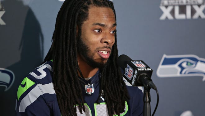 Seattle Seahawks cornerback Richard Sherman answers questions put to him by the media at a team press conference at the Arizona Grand Resort in Phoenix on Jan. 28, 2015.