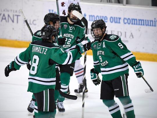 Drake Caggiula celebrates the second North Dakota goal