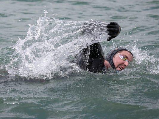 636319263191156001-052217-DFP-coach-swims-10-m.jpg