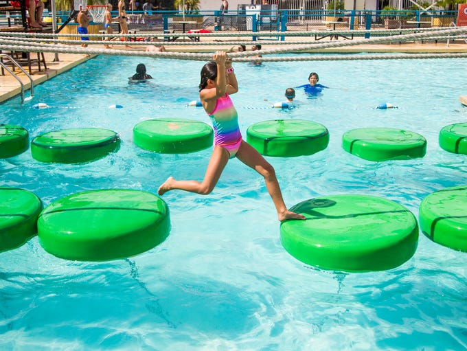 People enjoy playing in the water on a hot day at Golfland
