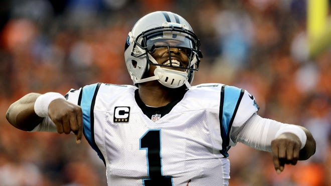 In this Sept. 8, 2016, file photo, Carolina Panthers quarterback Cam Newton celebrates a first-half touchdown pass against the Broncos during a game in Denver.