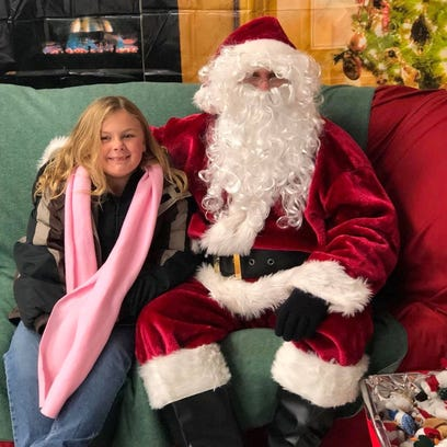 Santa stopped to talk to a friend at Ruidoso's annual